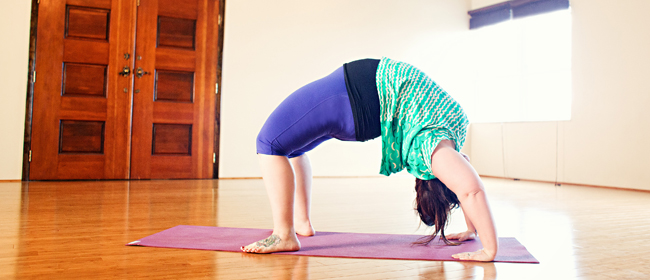 Image of me, a fat person, in urdvha dhanurasana or Wheel pose